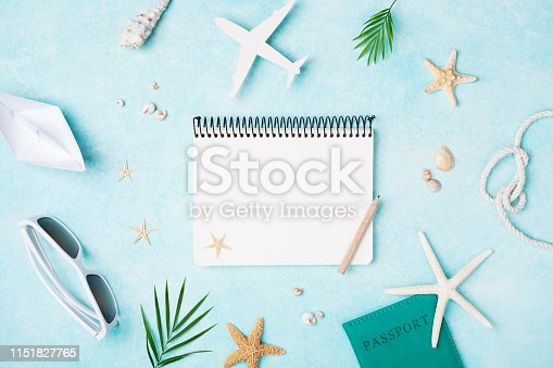 936373320 istock photo Planning summer holidays, travel and vacation background. Empty notebook with accessories on blue pastel table top view. Flat lay. 1151827765