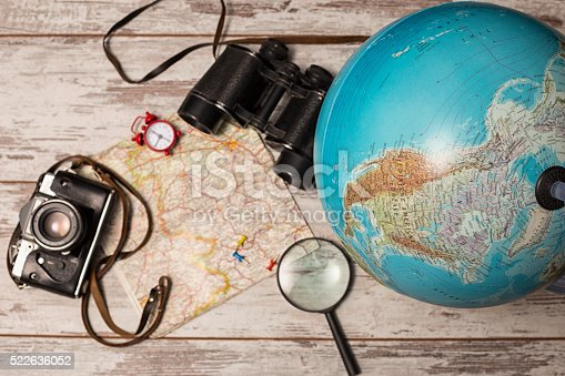 travel picture set with camera, binocular,globe, magnifying glass on map