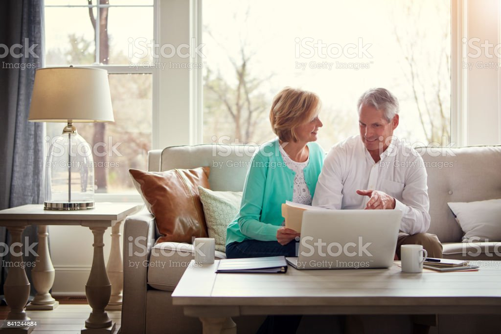 Planning their finances to ensure a comfortable retirement stock photo