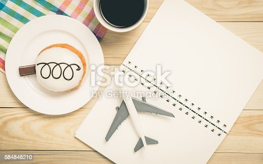 istock Planning your colorful vacation trip on a cafe table 584848210