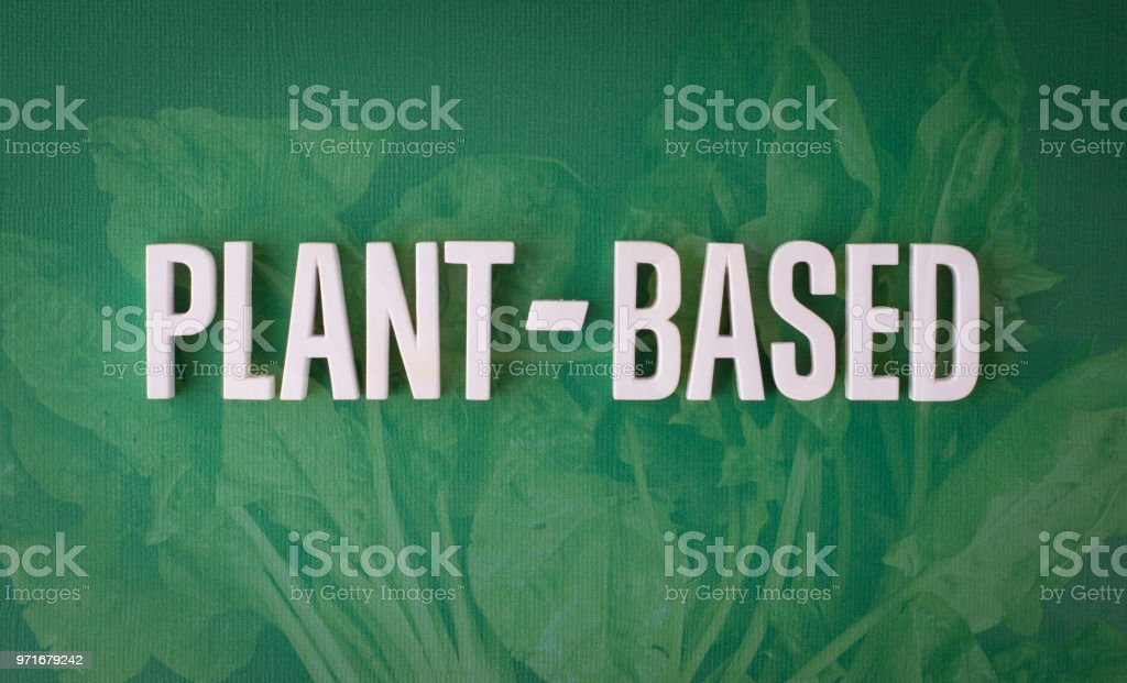 Plant based lettering sign stock photo