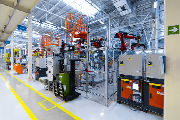 Plant for the production of cars. Open day at the automobile factory long corridor along robots that manufacture cars. latest technological neutral technologies of production of cars at plant. Assembly shop for modern cars mechanical engineering stock pictures, royalty-free photos & images