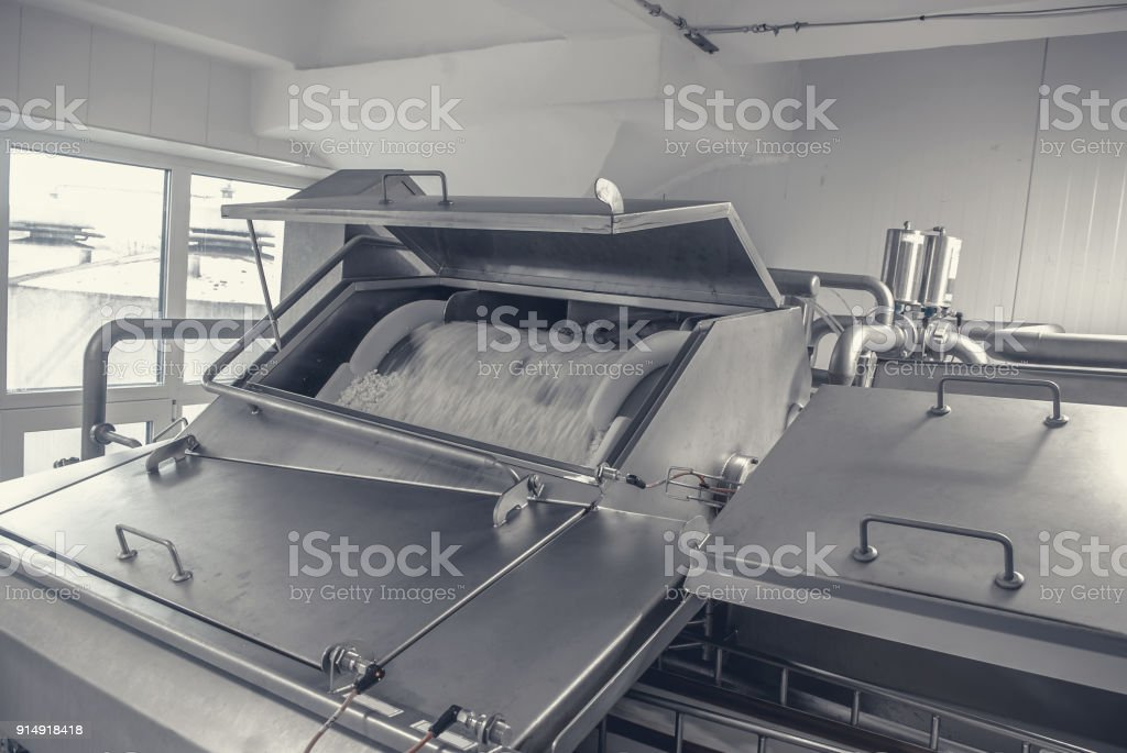 Plant for the production of cheese on a dairy factory stock photo