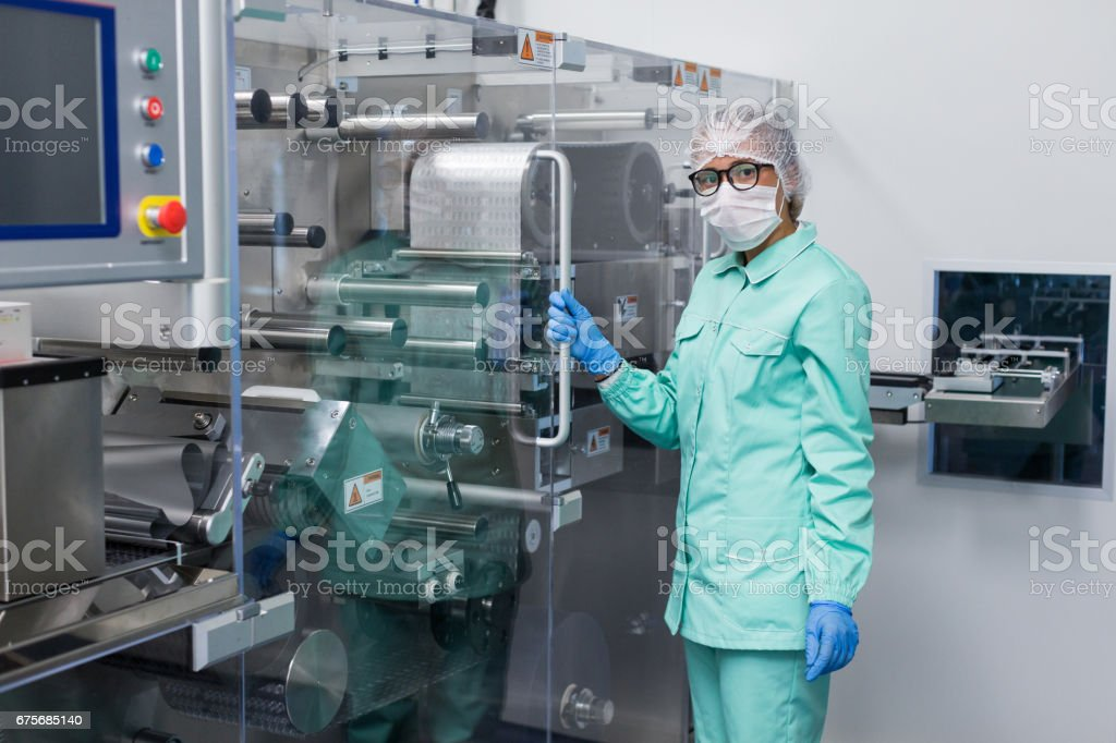 plant picture, manufacture, scientist near machine royalty-free stock photo