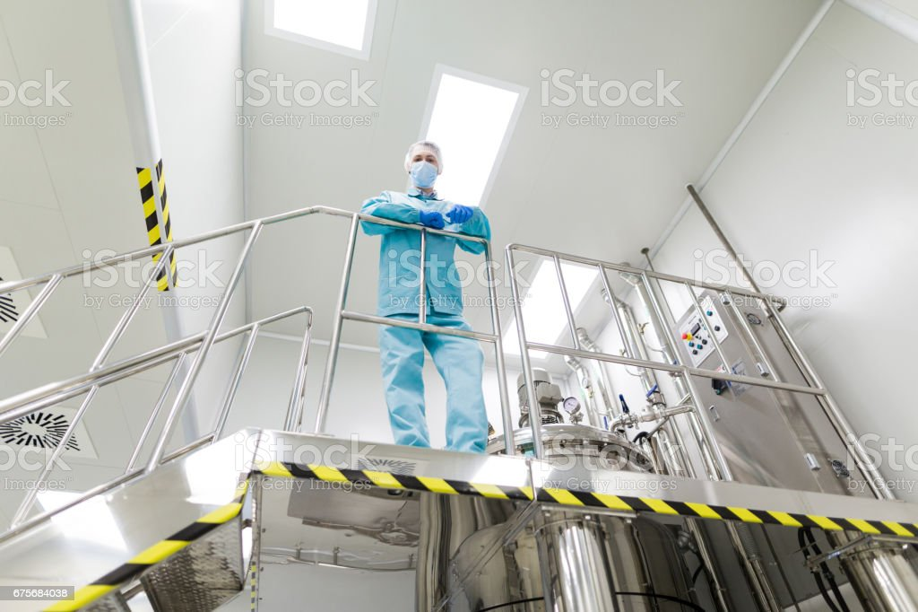 plant picture, scientist standing on ladder royalty-free stock photo