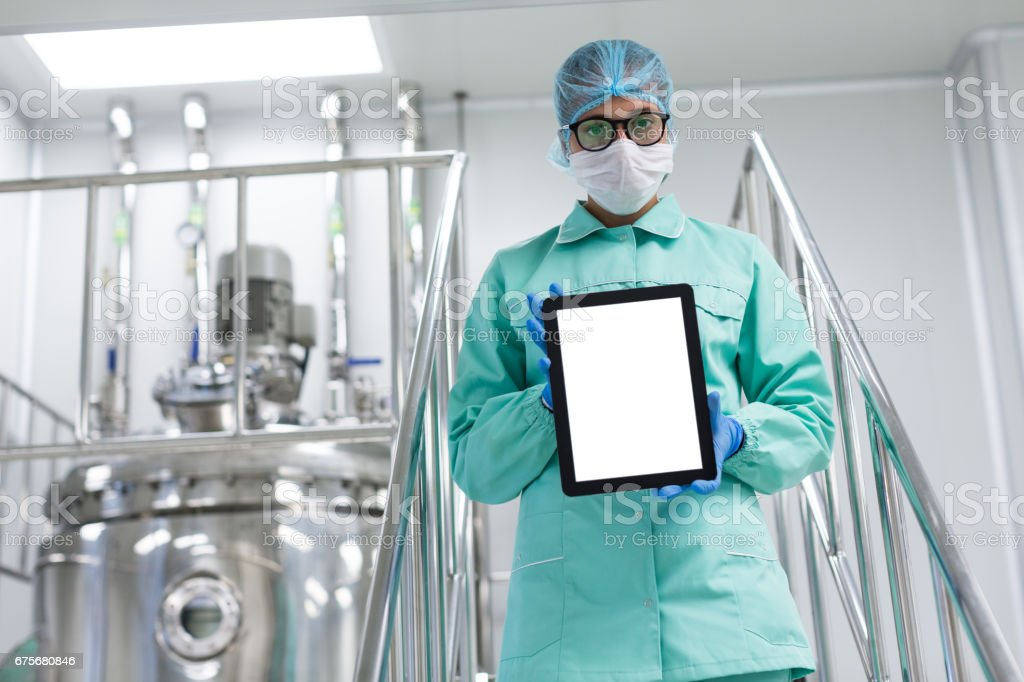 plant picture, scientist standing on steel stairs, hold empty tablet royalty-free stock photo