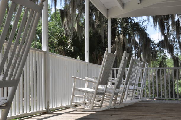 plantation style covered porch with rocking chairs - charming stock photos and pictures