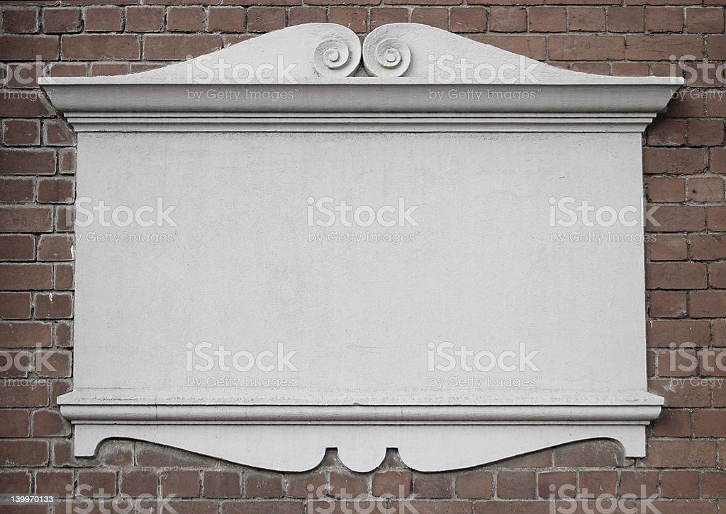 Plaque on brick wall stock photo