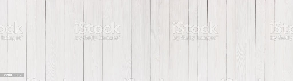 Plaques painted in white, wooden table or wall as background stock photo