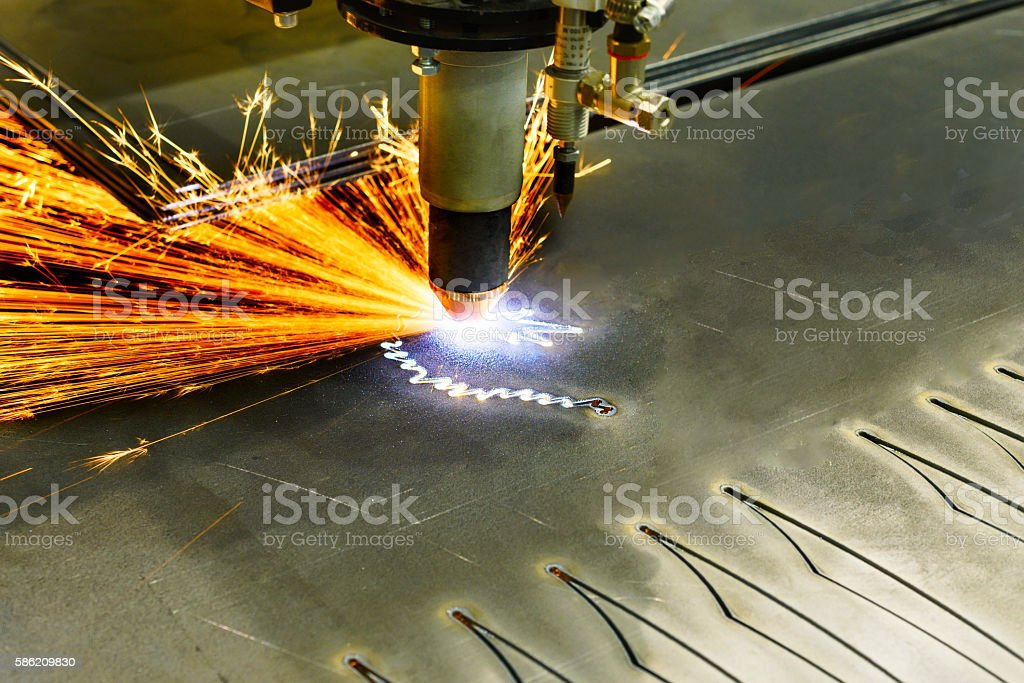 CNC plasma cutting machine during operation. stock photo