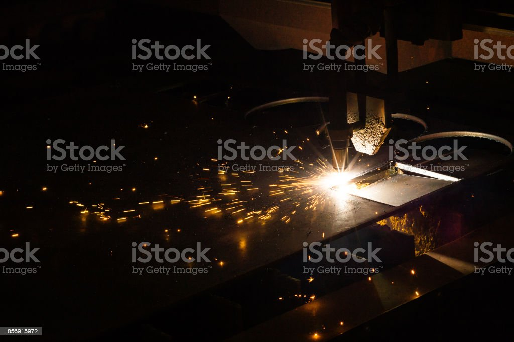 CNC plasma cutting machine during operation stock photo