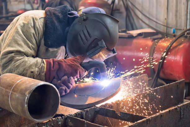 Plasma cutting parts from plate steel on a special stand stock photo