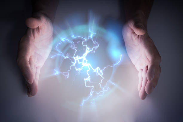 Plasma or electric lightning around hanbds of magician. stock photo