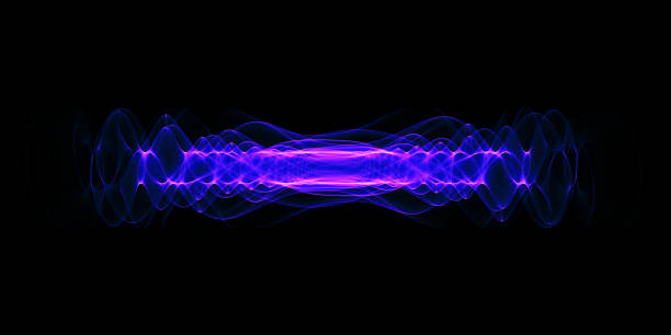 Plasma or high energy force concept. Blue-purple glowing energy waves isolated over black background. Plasma or high energy force concept. Blue-purple glowing energy waves isolated over black background. large hadron collider stock pictures, royalty-free photos & images