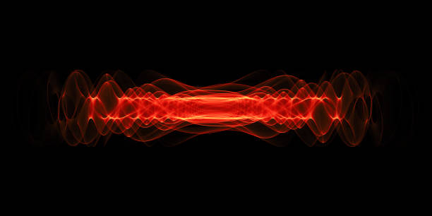 Plasma or high energy force concept. Red glowing energy waves isolated over black background. Plasma or high energy particles concept. Red glowing energy waves isolated over black background. large hadron collider stock pictures, royalty-free photos & images