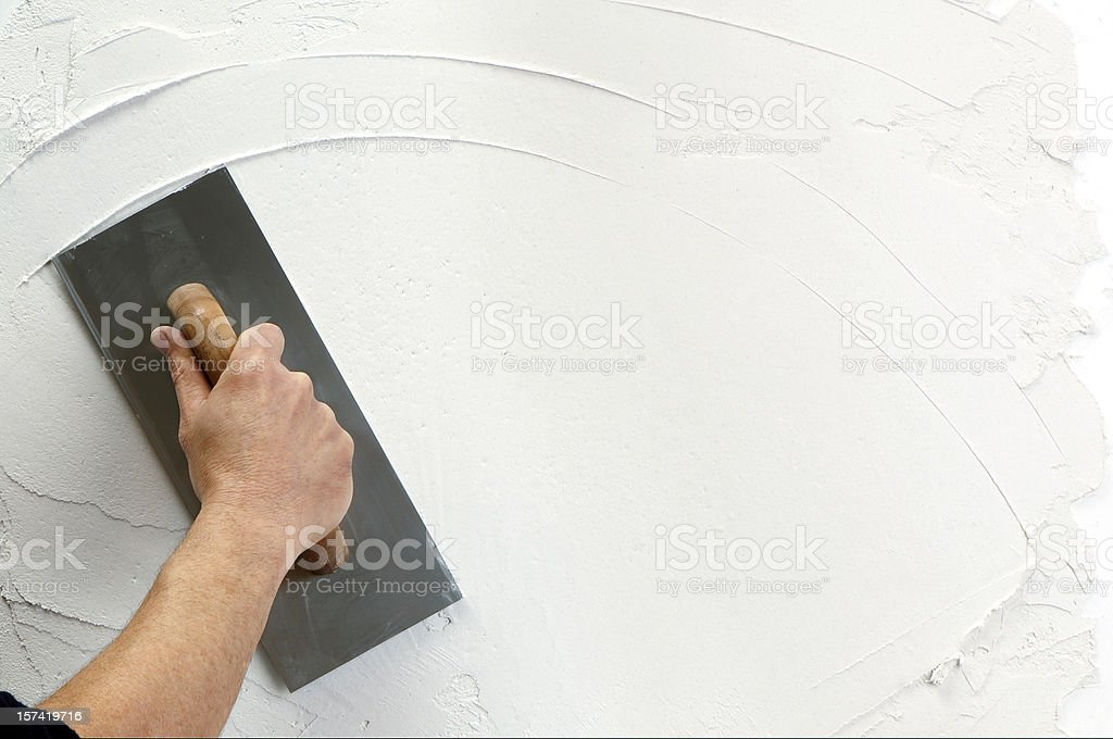 plaster application stock photo