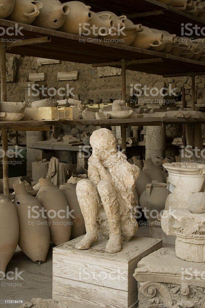 Plaster cast of Mount Vesuvius volcano victim boy at Pompeii stock photo
