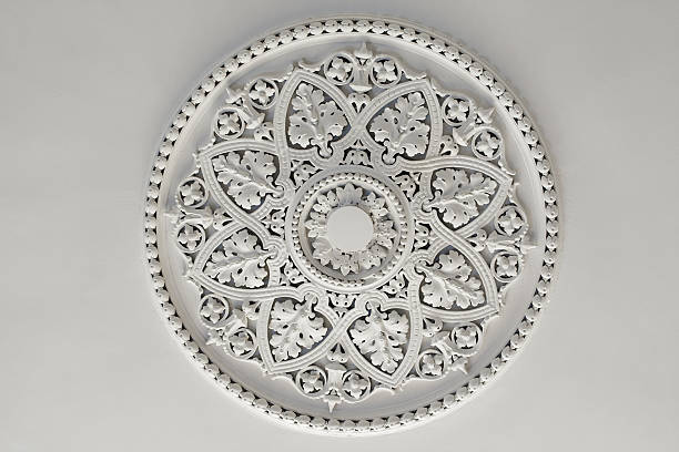 Plaster Ceiling Rose or plate Old antique plaster ceiling plate or rose in an old victorian house plaster ceiling design stock pictures, royalty-free photos & images