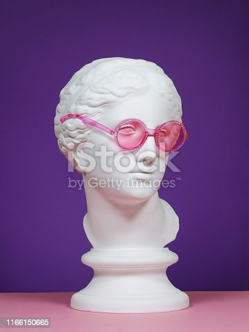 Plaster head model (mass produced replica of Head of Aphrodite of Knidos) wearing pink eyeglasses