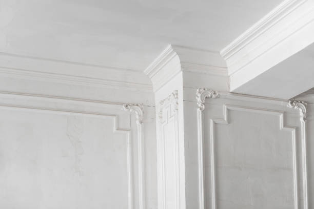 plaster molding in the room unfinished plaster molding on the ceiling and columns. decorative gypsum finish. plasterboard and painting works plaster ceiling design stock pictures, royalty-free photos & images