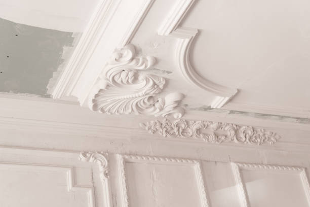 plaster molding in the room unfinished plaster molding on the ceiling. decorative gypsum finish. plasterboard and painting works plaster ceiling design stock pictures, royalty-free photos & images