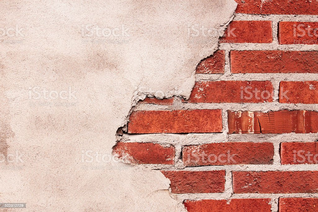 Plaster on a brick wall stock photo