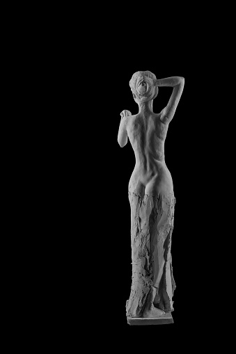 868668668 istock photo plaster statue of a naked girl on a black background isolated 872980466