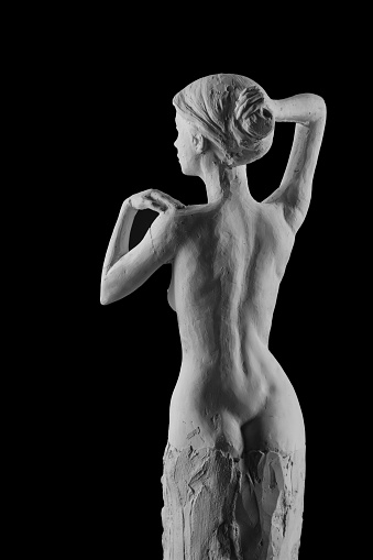 868668668 istock photo plaster statue of a naked girl on a black background isolated 872982986