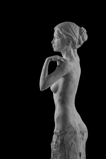868668668 istock photo plaster statue of a naked girl on a black background isolated 872983080