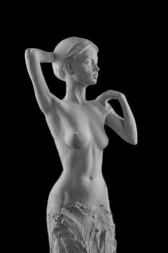 868668668 istock photo plaster statue of a naked girl on a black background isolated 872983210
