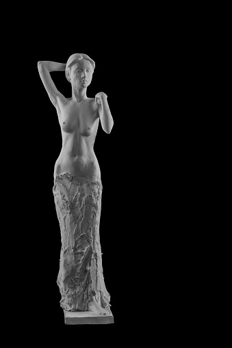 868668668 istock photo plaster statue of a naked girl on a black background isolated 872983336