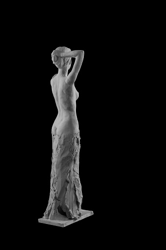 868668668 istock photo plaster statue of a naked girl on a black background isolated 872983354