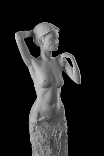 868668668 istock photo plaster statue of a naked girl on a black background isolated 872983382