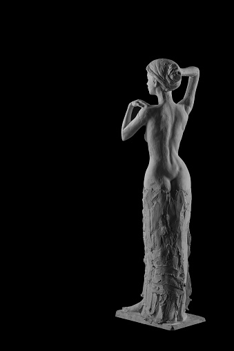 868668668 istock photo plaster statue of a naked girl on a black background isolated 872983594
