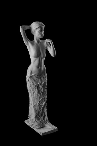 868668668 istock photo plaster statue of a naked girl on a black background isolated 872983628