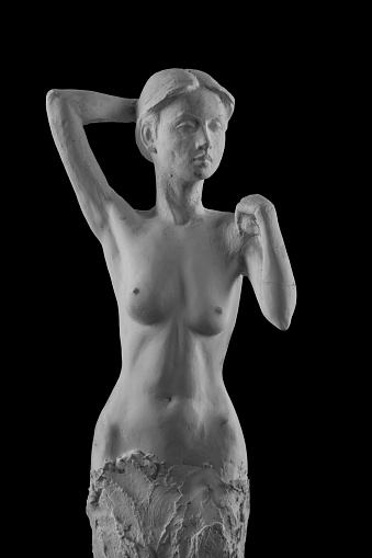 868668668 istock photo plaster statue of a naked girl on a black background isolated 872983688