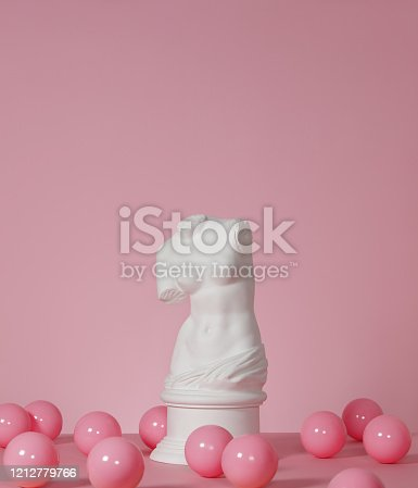 Plaster model of female torso (mass produced replica of Venus de Milo) and pink color balls