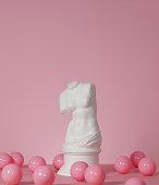 Plaster model of female torso (mass produced replica of Venus de Milo) and pink color balls