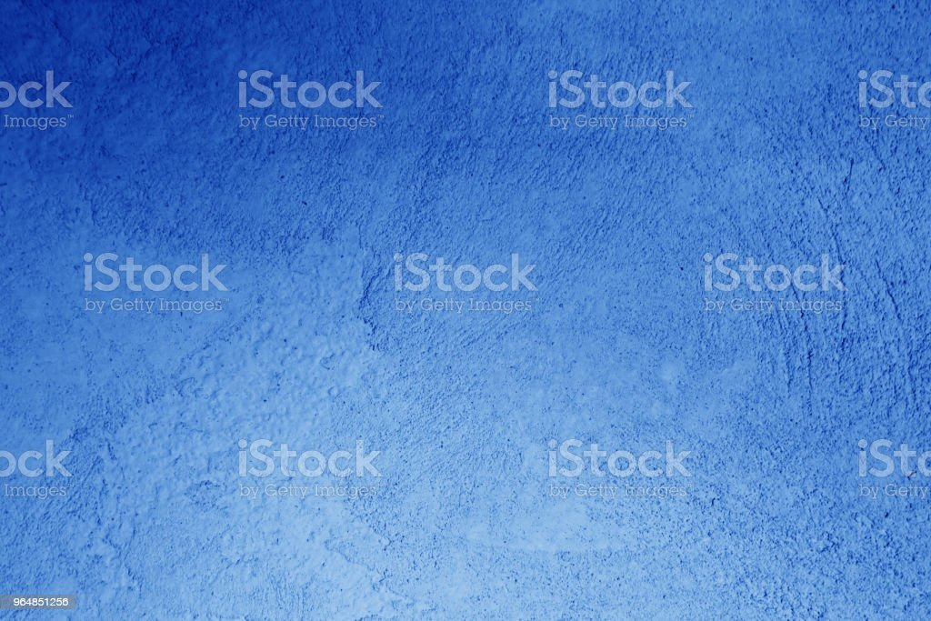 Plaster wall texture in navy blue color. royalty-free stock photo
