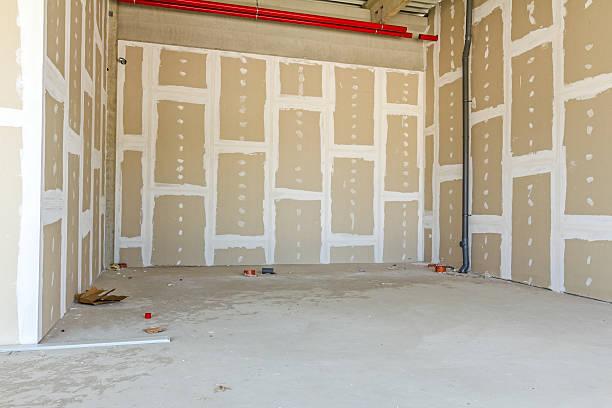 Plaque de plâtre murs. Gypse mur en cours de construction. - Photo
