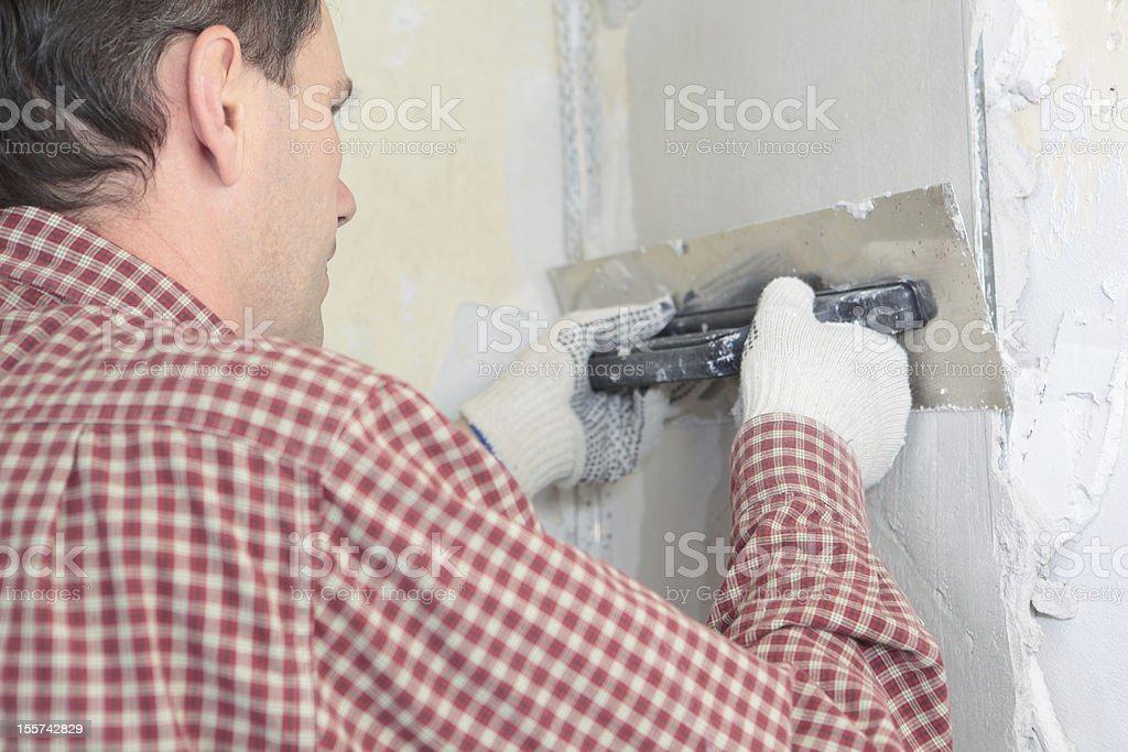 Plasterer at work royalty-free stock photo