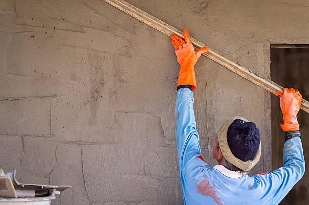 plasterer man and his job stock photo