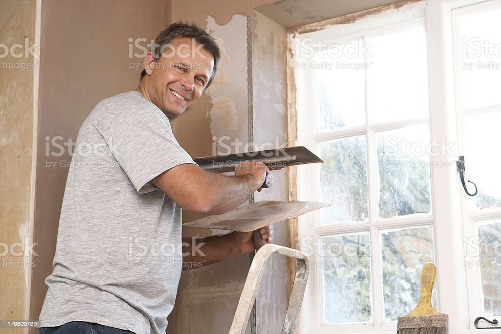 Plasterer Working On Interior Wall royalty-free stock photo