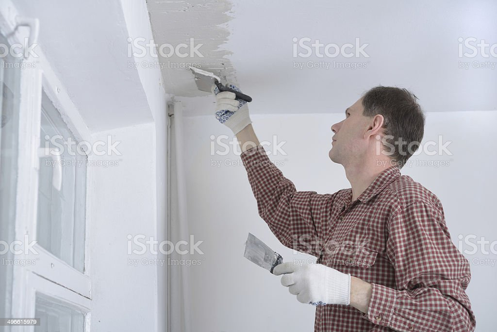 Plastering a ceiling stock photo