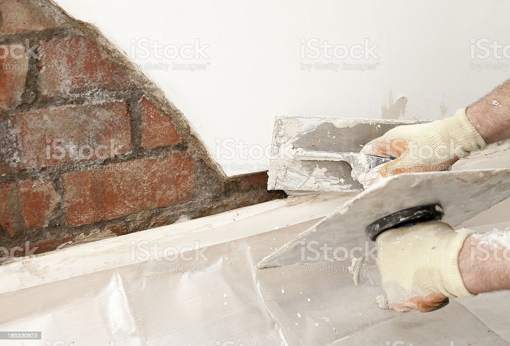 Plastering a wall stock photo
