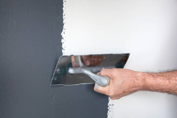 Plastering of a Concrete Wall stock photo