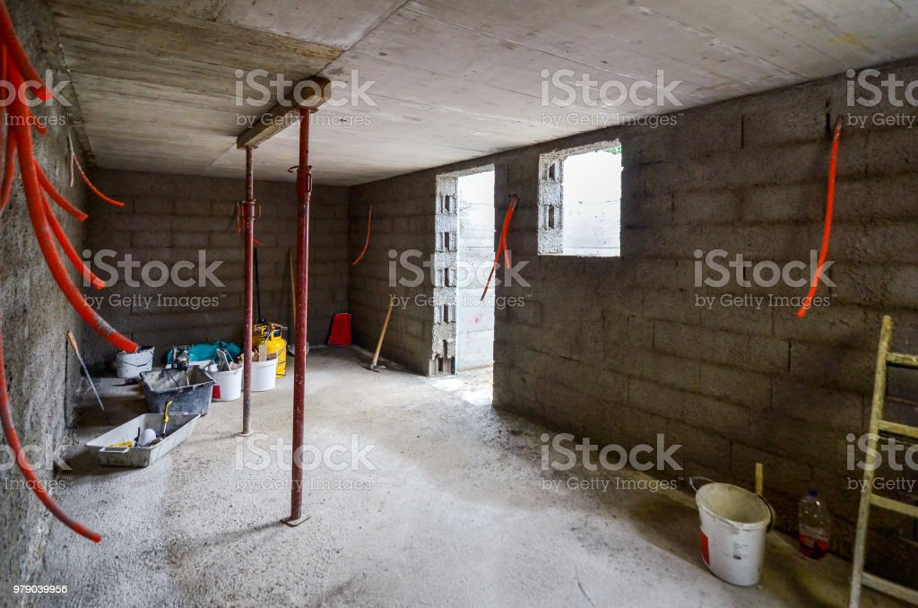 Plastering, rebuilding, waterproofing basement or a cellar and work tools. stock photo