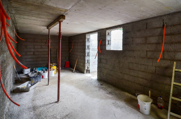 Plastering, rebuilding, waterproofing basement or a cellar and work tools. Plastering, rebuilding, waterproofing basement or a cellar and work tools. Construction of residential house cellar or basement with electric installations and freshly plastered walls. waterproof stock pictures, royalty-free photos & images