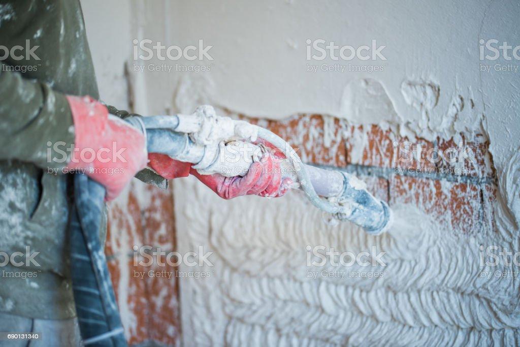 Verputzen mit Verputzen Pumpe – Foto
