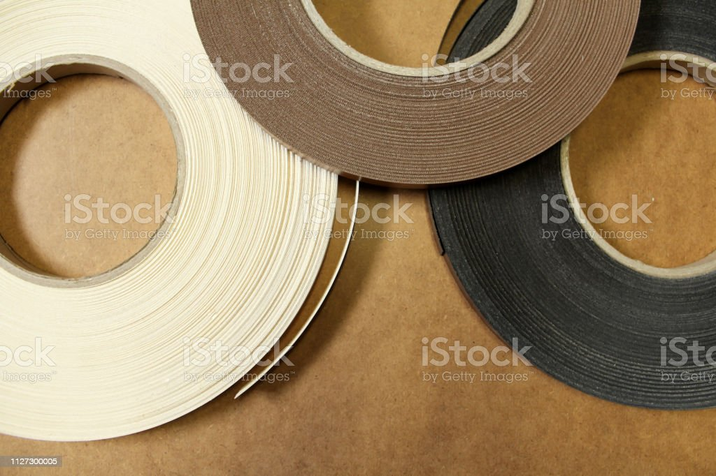 Plastic and paper edge for pasting furniture.